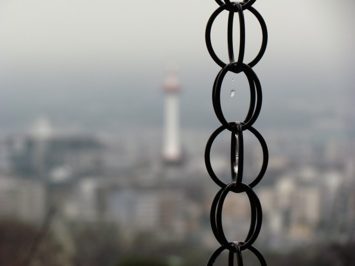 Water dripping down a chain at Kiyomizu dera, looking out over Kyoto in the background